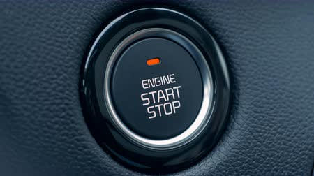 стартер : Cars ignition button is getting pushed to start and stop the vehicle Стоковые видеозаписи