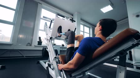 paralympics : Handicapped sportsman training in a gym, back view. Stock Footage