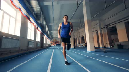 paralympics : Sportsman runs, wearing prosthesis, close up.