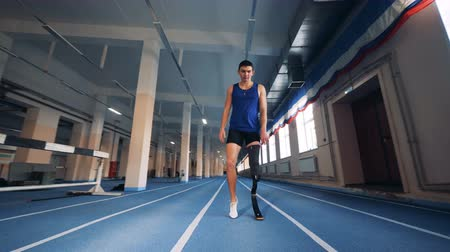 paralympics : A runner with prosthesis warming up, close up. Stock Footage