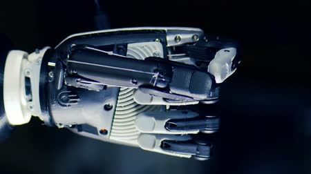 droid : Close up of a cybernetic hand clenching fingers Stock Footage