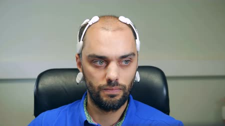 neuro : Front view of a man wearing a bio-signal EEG headset