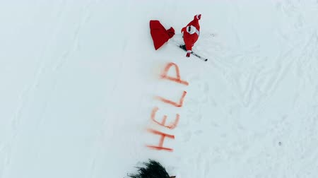 sos : Santa Claus in skis and with presents is crying for help
