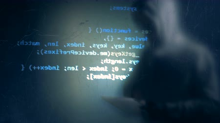 fraudster : Cyber crime and hacking concept. One fraudster uses tablet to hack system, close up.
