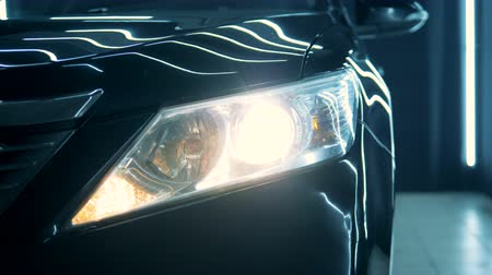 polido : Close up of an automobiles headlight