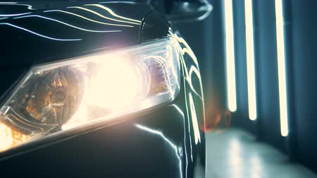 seçkinler : Radiating headlight of a black car in a workshop Stok Video