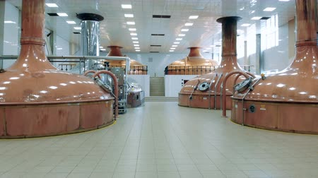 fermenting : Spacious hall of a brewery with copper tanks