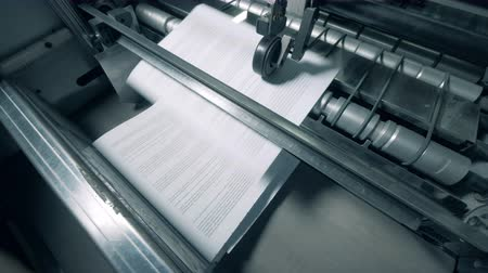 nakladatelství : Newly-printed pages are being issued by the industrial press