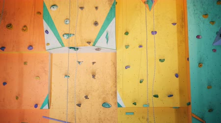 rock wall : Colored wall for climbing, close up. Stock Footage