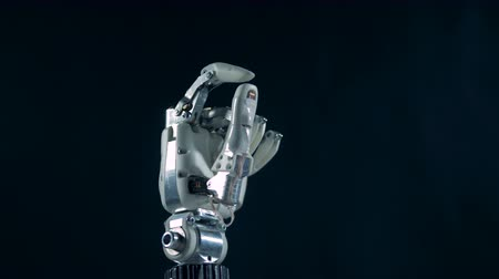 prosthesis : A robotic hand works, moving fingers, close up.