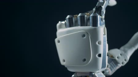 inovador : Close up of human fingers touching a bionic hand and making it move Vídeos