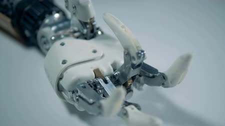 bending : Close up of clenching fingers of a robotic hand Stock Footage