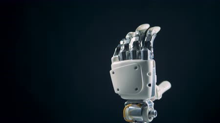 робот : A person is making a robotic hand moving its fingers Стоковые видеозаписи
