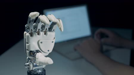 inventing : Bionic hand with moving fingers is getting controlled from a computer Stock Footage