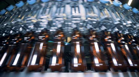 capturados : Plastic beer bottles captured in the industrial machine are moving round