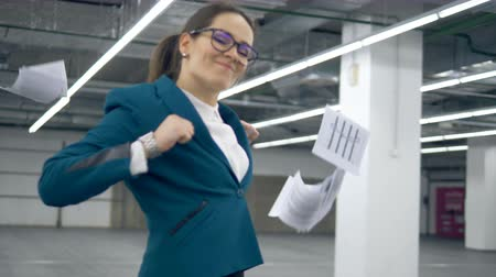 捨てる : Businesswoman is dancing happily after throwing papers away 動画素材