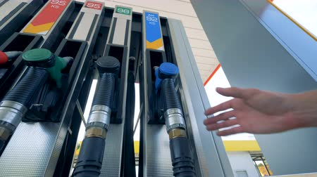benzine : One fuel pistol is being taken out from a gas pump. Gasoline, gas, fuel, petroleum concept.