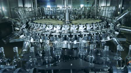 sterility : Automated machine washes bottles at alcohol production factory.