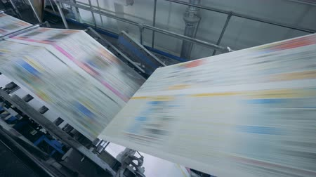 nakladatelství : Working conveyor at a printing office, close up.