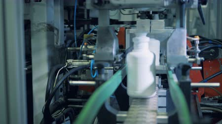 sterility : Plant machine moves bottles on a conveyor, modern technology. Stock Footage