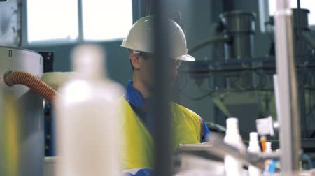 technological process : Male engineer working with a tablet, checking plant machines. Stock Footage