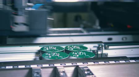integrált : Factory equipment creating PCB, printed circuit board, circuit board, printed board, printed circuit.