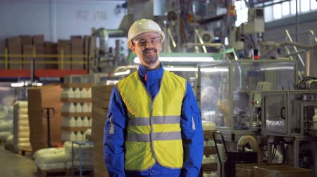 polymers : Smiling male worker in the functioning factory facility Stock Footage