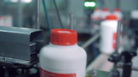 labeled : Labeled plastic bottles are moving and rolling in a close up Stock Footage