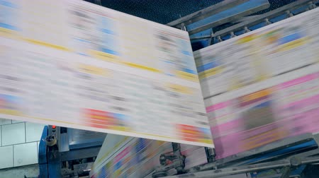 ofset : Newspaper pages on a typographical conveyor, close up.