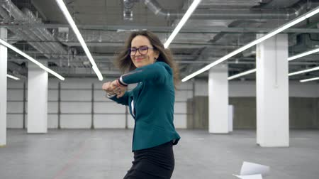 free throw : Happy office worker starts to dance and throws away documents.