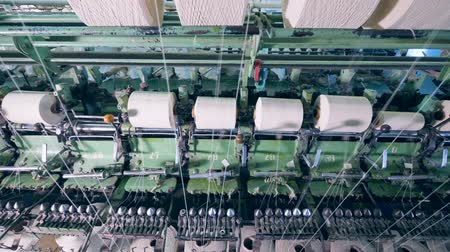 meada : Plant machines spin sewing spools to reel threads. Stock Footage