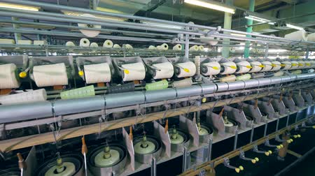 meada : Spinning machines work at textile factory, spooling thread on clews. Stock Footage