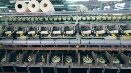 spool : Automated equipment works at a factory, coiling threads on clews. Stock Footage