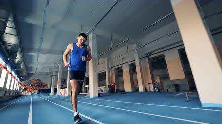 amputated : Sprinter wears leg prosthesis while running on a track, prosthetic leg.