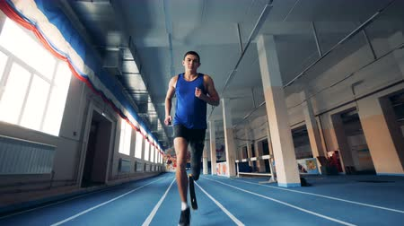 paralympic : Male runner training with a prosthesis, bionic leg.