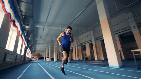 paralympic : One man with artificial leg running on a track, modern prosthesis.