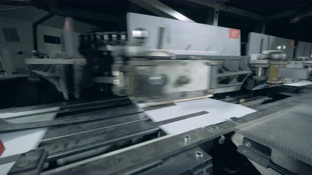 creased : Binding machine is attaching paper covers to the edges