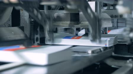 mechanically : Edges of printed books are getting cut off mechanically