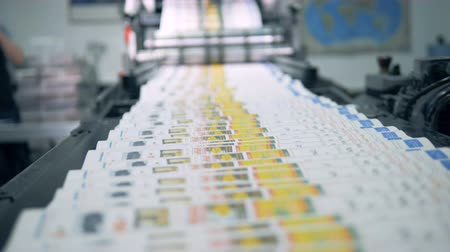 üreten : Coloured printed magazines are moving along the conveyor belt Stok Video