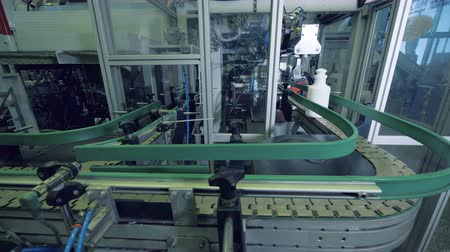 mechanically : Factory conveyor transporting plastic bottles