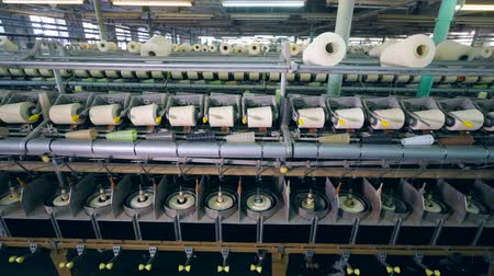 poliester : Textile factory unit with white threads getting wound