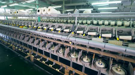 inacabado : Clothing factory unit with reels getting wound in a textile factory. Stock Footage