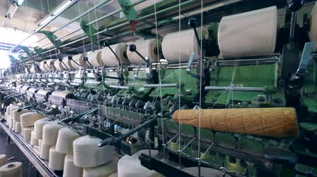 clothes line : Garment factory machine is winding threads. Textile factory equipment.