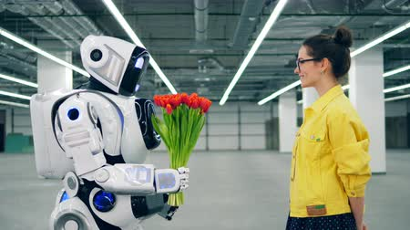 sintético : Human-like robot is giving flowers to a young woman Stock Footage