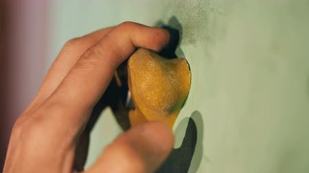 bouldering : Close up of a bouldering rock being clenched in a male fist