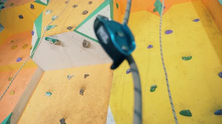 carabine : Yellow climbing wall of a bouldering gym Stock Footage