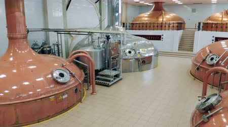 fermenting : Factory containers store beer at a modern brewery.