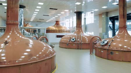 microbrewery : Factory room with big tanks, brewing beer.