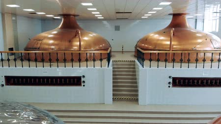 reservoir : Process of beer brewing in metal tanks at a factory.