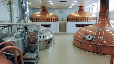 cylinder : Modern equipment works at a brewing plant, making beer in containers. Stock Footage